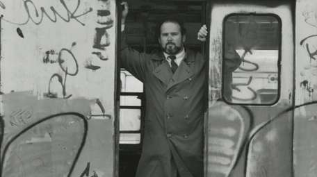 Jim Dwyer in old subway car at yard