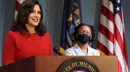Michigan Gov. Whitmer addresses the state during a