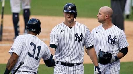 The Yankees' Brett Gardner, right, stands with Aaron