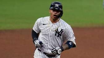 The Yankees' Gleyber Torres reacts as he rounds