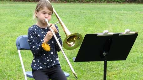 In West Islip, band students, like fifth-grader Aine