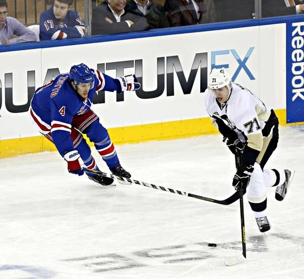 Rangers defenseman Michael Del Zotto marks Pittsburgh Penguins