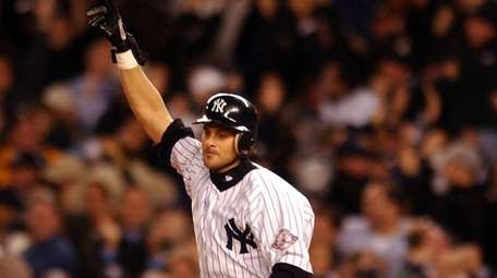 Aaron Boone rounds the bases after hitting a