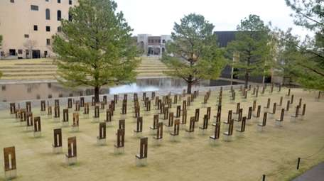 168 symbolic empty chairs stand on the memorial