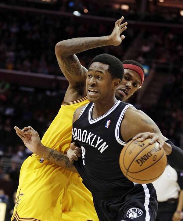 Nets' MarShon Brooks, front, drives past Cleveland Cavaliers'