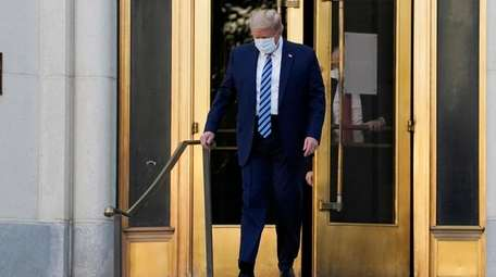 President Donald Trump walks out of Walter Reed