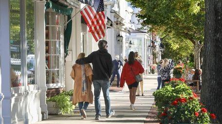 Pedestrians walk along Main Street in Southampton.