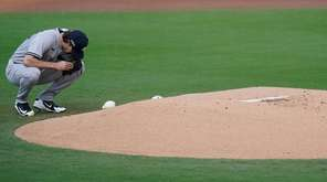 New York Yankees starting pitcher Gerrit Cole kneels