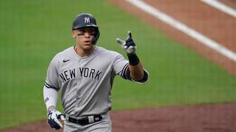 New York Yankees' Aaron Judge reacts after hitting