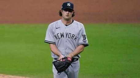 The Yankees' Gerrit Cole walks to the dugout