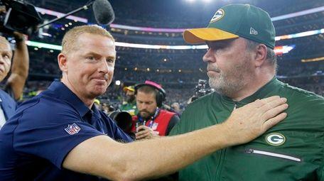 Then-Cowboys coach Jason Garrett, left, congratulates then-Packers coach