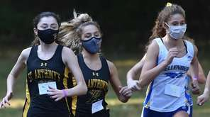 Kelly Parker of St. Anthony's, left, breaks from