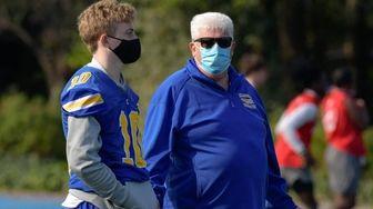 Kellenberg Head Coach, Kevin Hannafin, talks with player