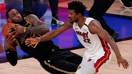 Lakers forward LeBron James pulls a rebound away
