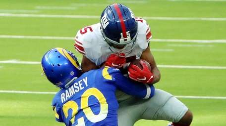 Jalen Ramsey of the Rams tackles Golden Tate