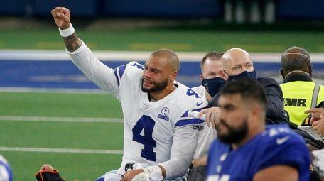 Dallas Cowboys quarterback Dak Prescott (4) lifts his