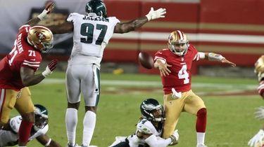 San Francisco 49ers quarterback Nick Mullens (4) fumbles