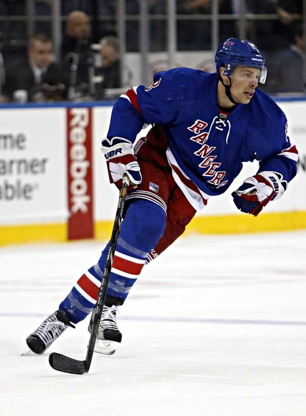 Rangers right wing Darroll Powe skates to the
