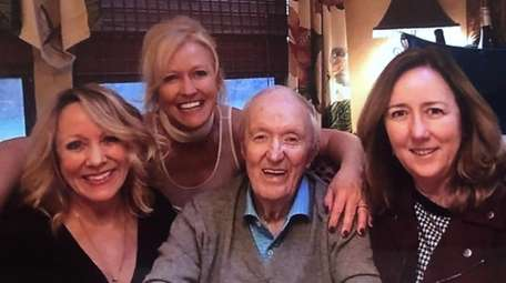 Joe Lucey with his three daughters, from left,