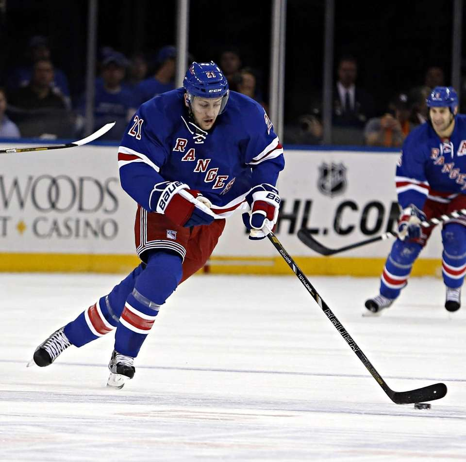 Rangers center Derek Stepan brings the puck up