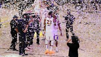 Los Angeles Lakers' LeBron James and Rajon Rondo
