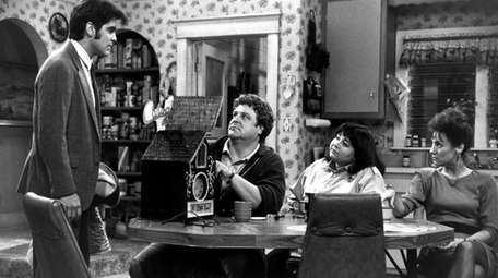 """Pictured in this scene from a 1988 """"Roseanne"""""""
