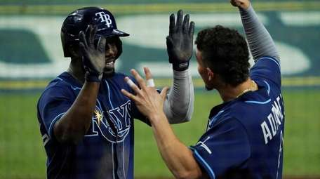 The Rays' Randy Arozarena, left, celebrates with Willy