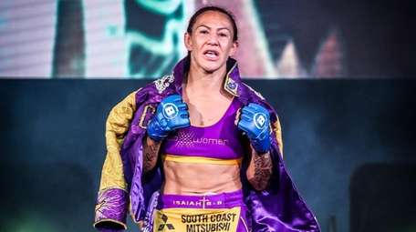Cris Cyborg Justino walks to the cage at