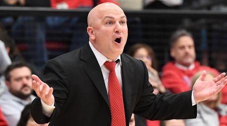 Stony Brook head coach Geno Ford react in