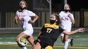 St. Anthony's Olivia Perez shoots against Sacred Heart