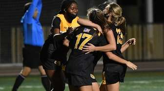 St. Anthony's players celebrate a goal by Olivia