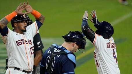 The Astros' George Springer celebrates with teammate Martin