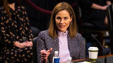 Supreme Court nominee Amy Coney Barrett responds during