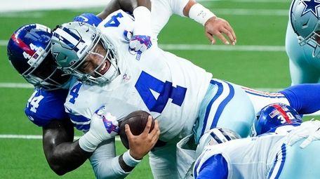 Cowboys quarterback Dak Prescott is sacked by Giants
