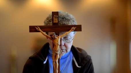 92 year-old Sister Eileen McCann is helped by