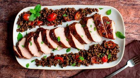 Roast pork tenderloin is glazed with pomegranate molasses,