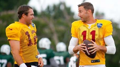 Washington's Colt McCoy, left, and Alex Smith on