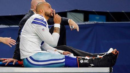 Cowboys quarterback Dak Prescott points skyward as he
