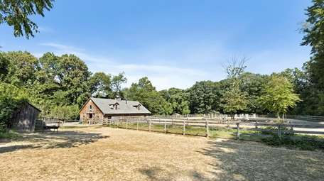 The horse farm is nestled on 5 acres