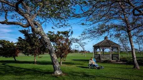 A person relaxes in Wantagh Park in Wantagh