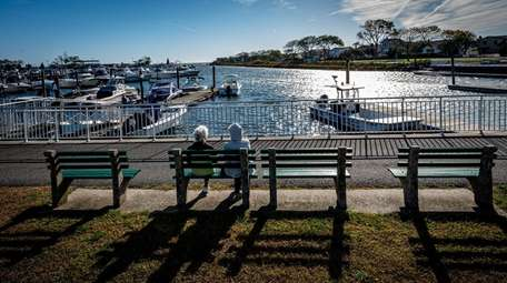 People relax at the marina near Wantagh Park