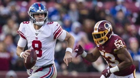 Daniel Jones of the Giants looks scrambles as