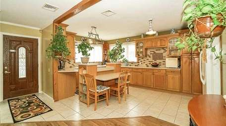 The house has an updated kitchen, including custom