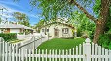 The fully fenced quarter-acre yard has a 20-by-10-foot