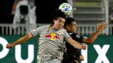 Red Bulls forward Brian White, left, and Inter