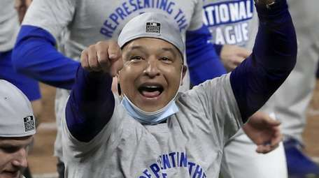 Dodgers manager Dave Roberts celebrates with his team