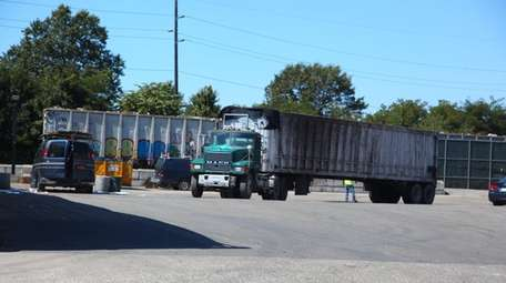 Trucks at One World Recycling on Queens Avenue