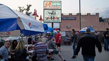 People dine outside at L&B Spumoni Gardens in