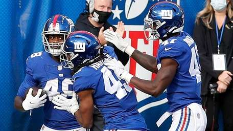 Tae Crowder of the Giants celebrates with his