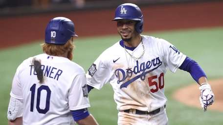 Mookie Betts of the Dodgers is congratulated by